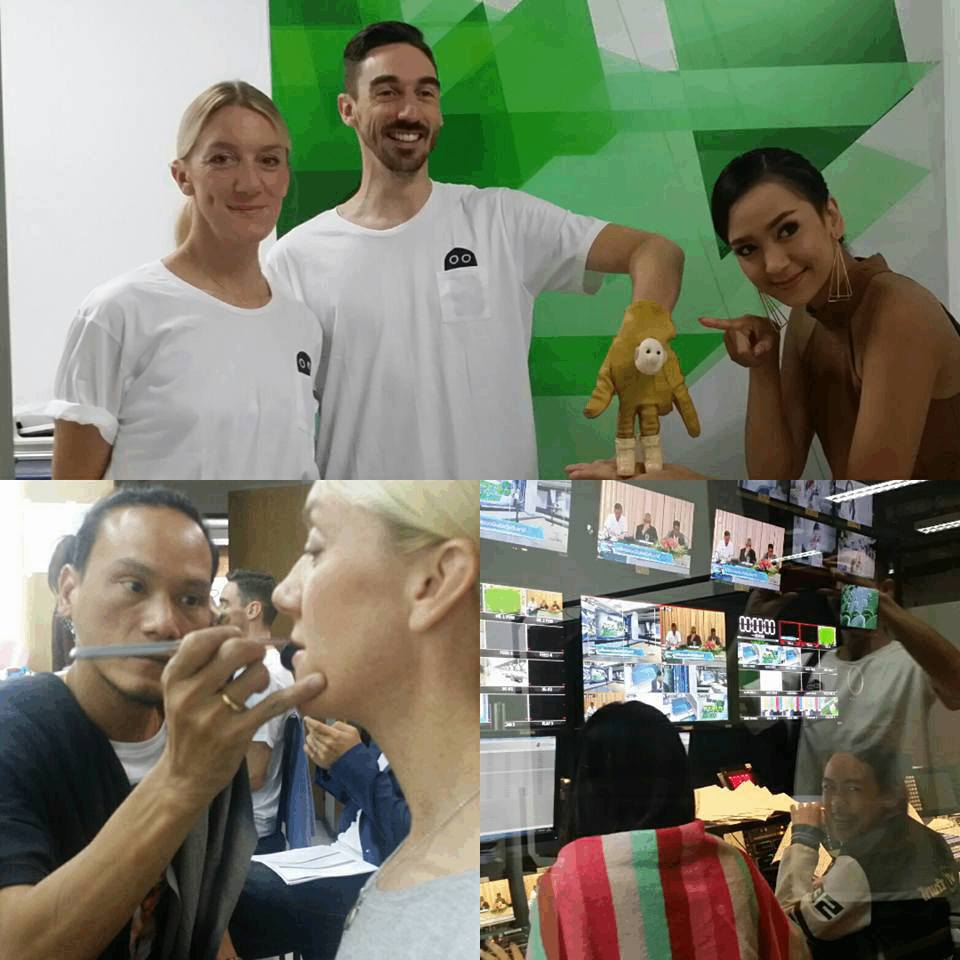 four pictures of our cast Laura and Simon preparing for an appearance on Thai TV, one image has a puppet made of of a leather glove, wearing boots and a little face