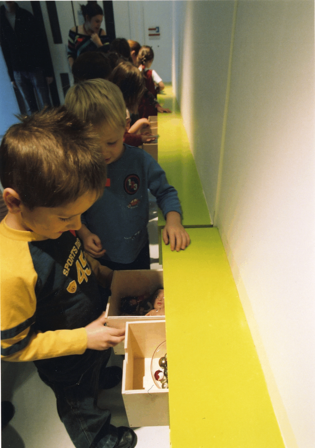 children explore boxes full of collected objects